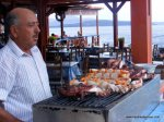 Our enthusiastic octopus skewer chef, Spiros